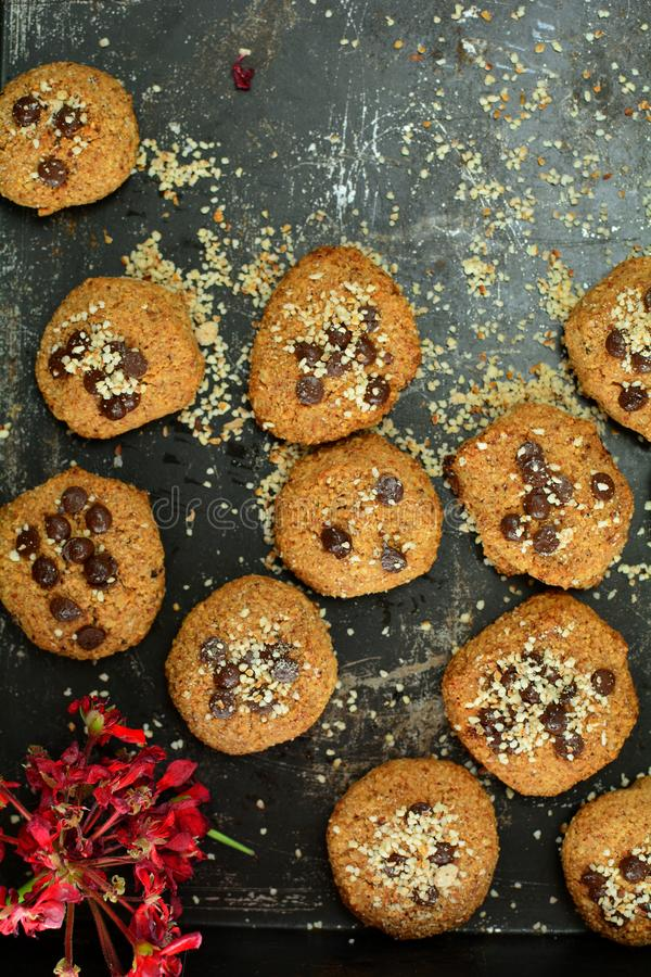 Keto Peanut Butter Cookies with Almond Flour and Sugar-Free Chocolate Chips. A set of photos showing a delicious sugar-free cookies with almond flour and peanut royalty free stock images