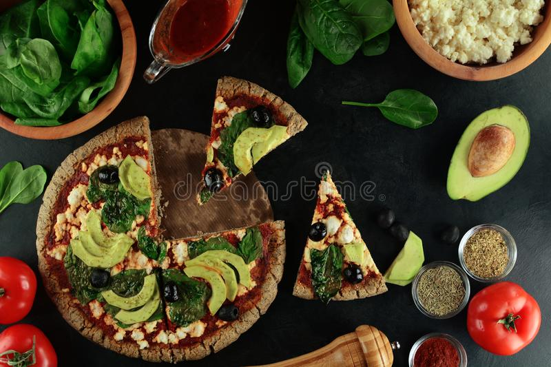 Keto Pizza with Sugar Free Tomato Paste, Crumbled Cheese, Spinach, Avocado and Olives. A set of photos showing low-carb, sugar-free keto diet pizza with keto royalty free stock images