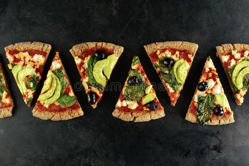 Keto Pizza with Sugar Free Tomato Paste, Crumbled Cheese, Spinach, Avocado and Olives. A set of photos showing low-carb, sugar-free keto diet pizza with keto royalty free stock photography