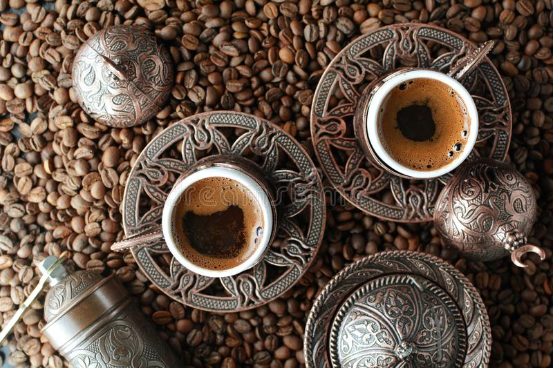 Turkish coffee served in traditional Ottoman cups. A set of photos showing Turkish coffee served in lovely Ottoman cups stock image