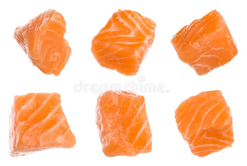 Set with pieces of fresh raw salmon on background. Fish delicacy. Set with pieces of fresh raw salmon on white background. Fish delicacy royalty free stock images