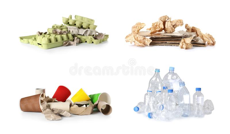 Set of piles with different garbage on white background. T royalty free stock photo