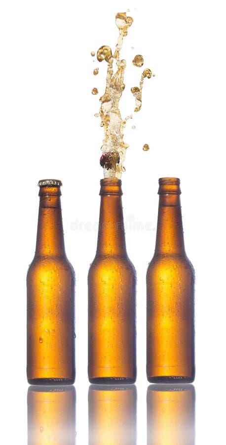 Set piwne butelki z strzelać korki zdjęcie stock
