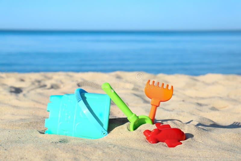 Set of plastic beach toys on sand. Near sea stock photography