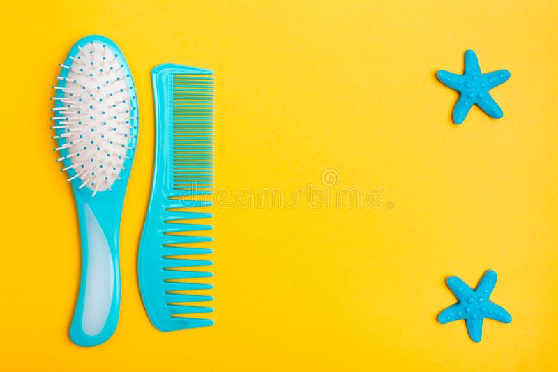 A set of plastic combs and two hairpins stock photos