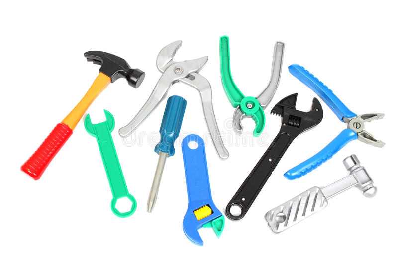 Set of plastic toy tools. Over white background royalty free stock image