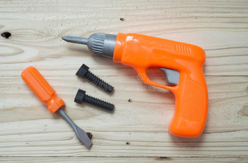 Set of plastic toy tools over wooden. Background royalty free stock photos