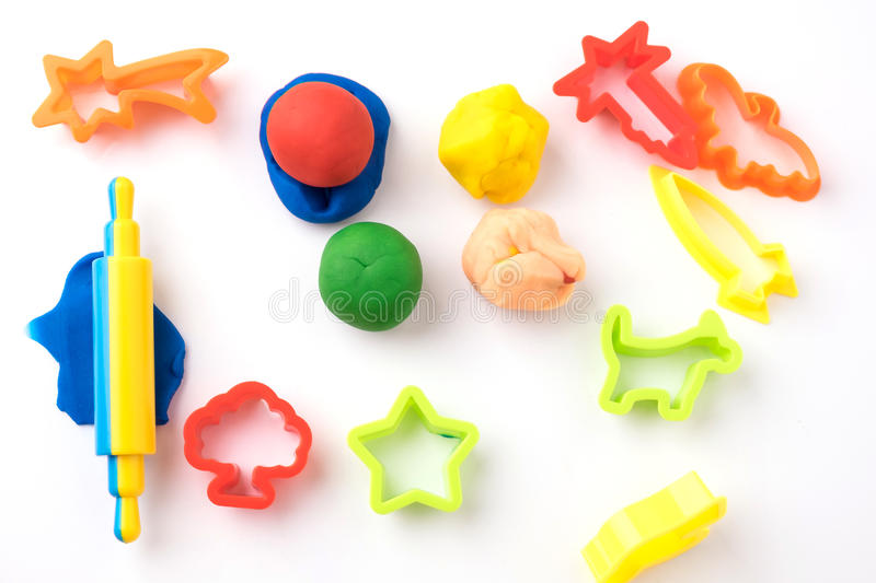 Set of play dough and plastic cutting block on white. Background royalty free stock image