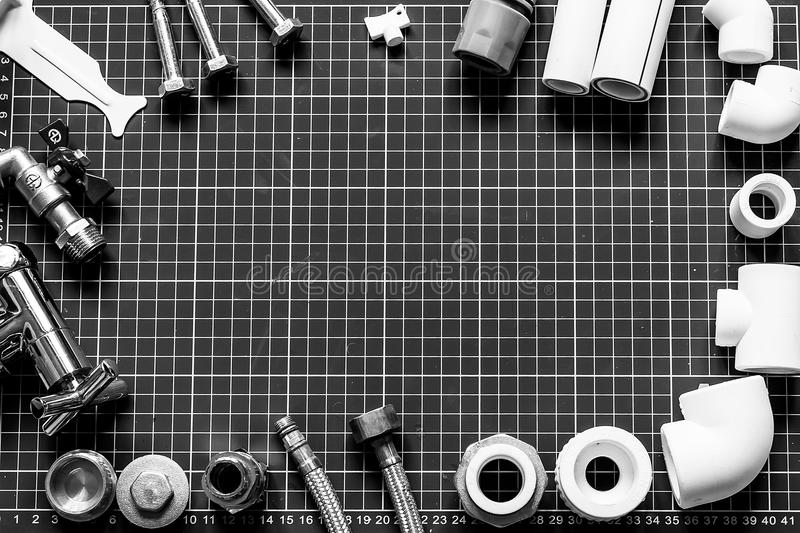 Set plumbing and tools on a black and white background. stock photo