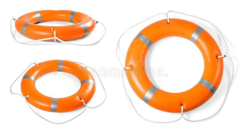 Set pomarańczowi lifebuoy pierścionki na bielu zdjęcia stock