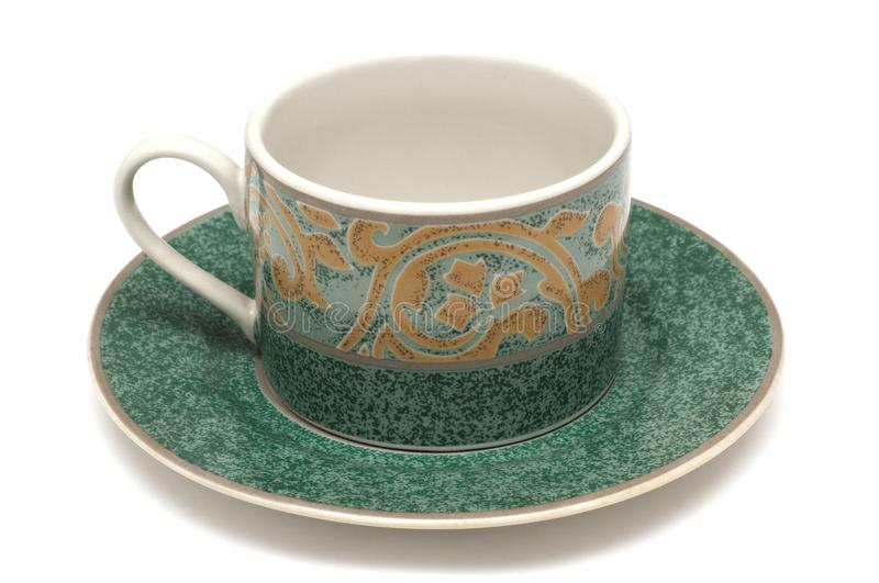 A set of porcelain tea cup and saucer. A photo taken on a set of porcelain tea cup and saucer against a white backdrop stock photography