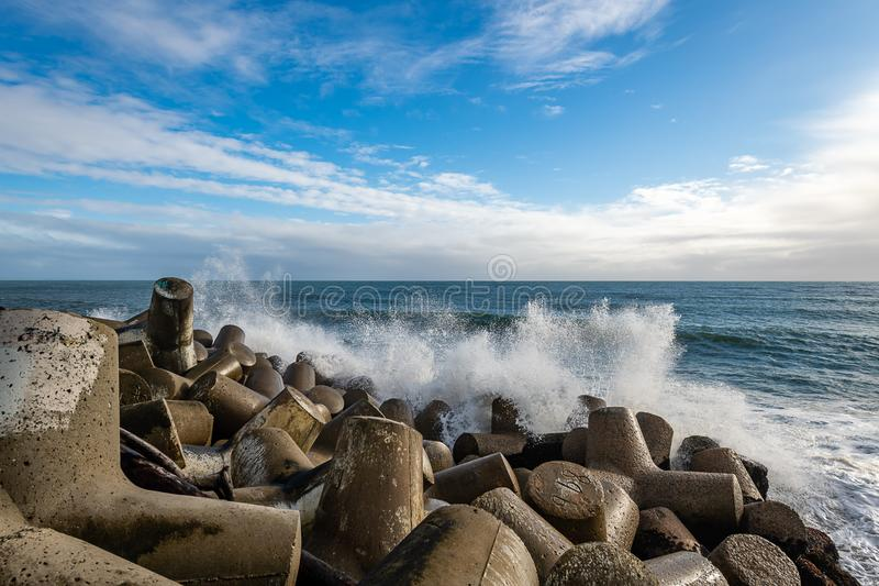 Crashing waves in Santa Cruz Harbor stock image