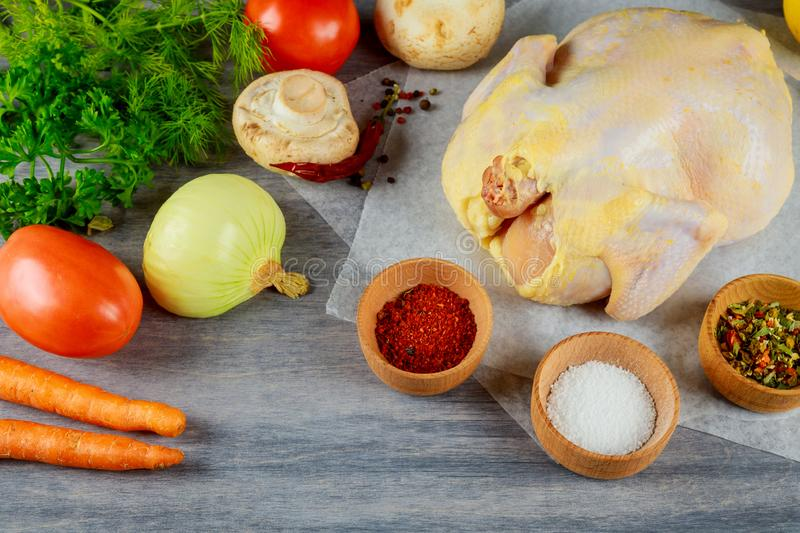 Organic raw chicken on wood with fresh ingredients for broth stock photos