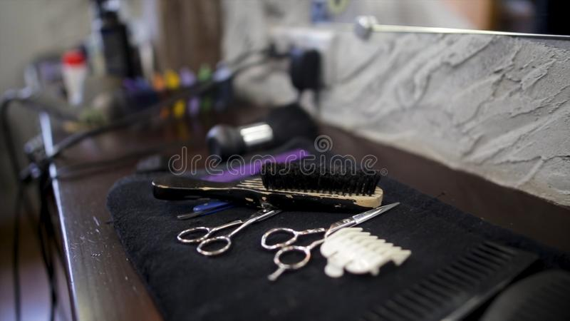 Set of professional hairdresser tools on light grey background. Hair Cutting and Thinning Scissors on vintage background stock image