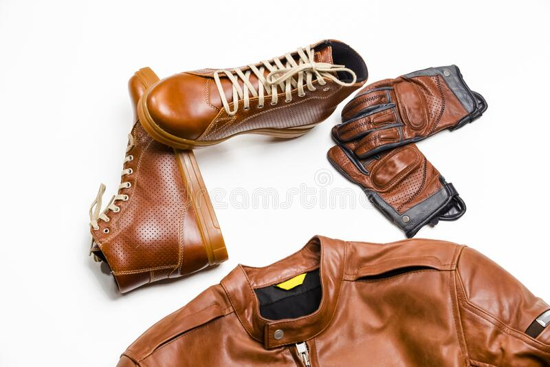 Set of Protective Moto Clothing Consisting of Leather Jacket, Leather Tan Boots and Stitched Crafted Protective Gloves. Horizontal Image stock images