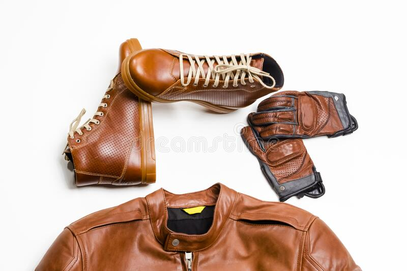 Set of Protective Moto Clothing Consisting of Leather Jacket, Leather Tan Boots and Stitched Crafted Protective Gloves. Horizontal Image Composition stock image