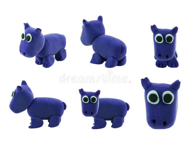 Set of purple hippopotamus made from plasticine stock image