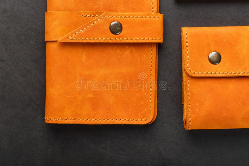 A set of purse, bag, partman, case for glasses and a key holder, made of genuine leather Nubuck on a dark background. Elements of leather craft products stock photography