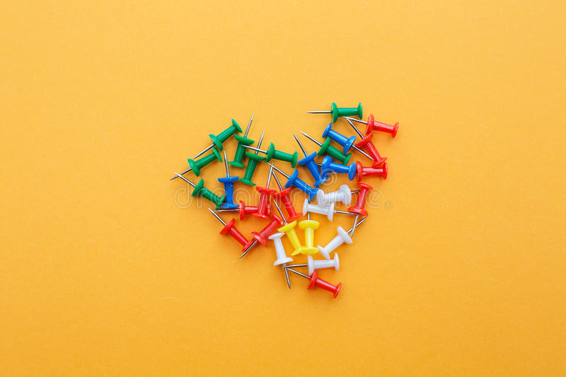 Set of push pins. In different colors royalty free stock images