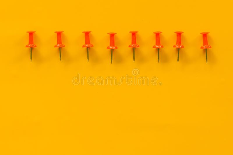 Set of push pins in different colors. Thumbtacks. Top view. on Yellow background. Space royalty free stock images