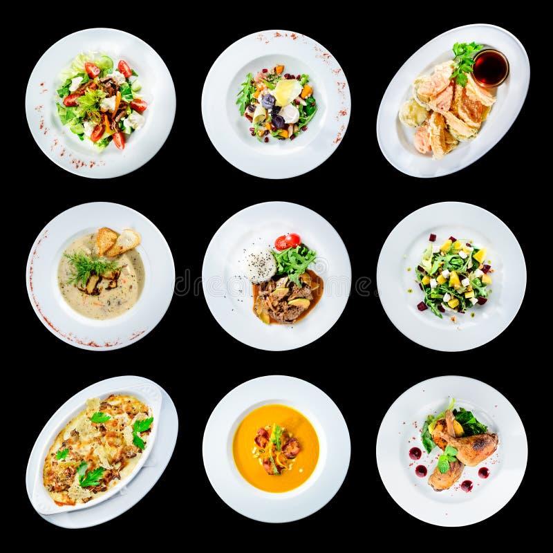 Set różnorodni talerze odizolowywający na czarnym tle z jedzenie obrazy stock