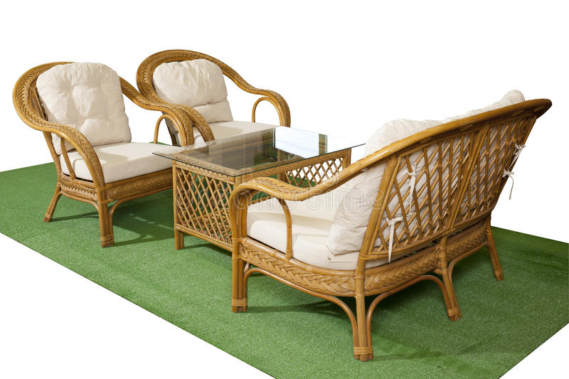 Set of rattan furniture on artificial grass isolated on white ba. Set of rattan furniture for balcony and garden on artificial grass isolated on white background royalty free stock image