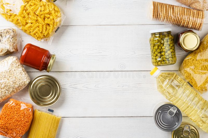 Set of raw cereals, grains, pasta and canned food stock photos