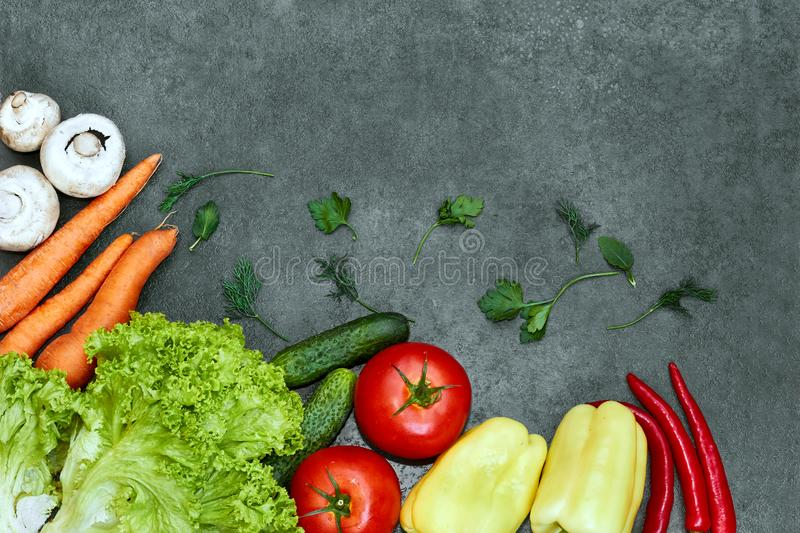 Set of Raw organic vegetables with fresh ingredients for healthily cooking on black  background, top view, banner. royalty free stock photo