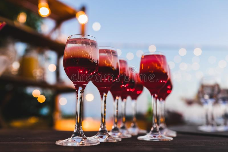 Set of red cocktails in vodka glasses on the bar royalty free stock photo