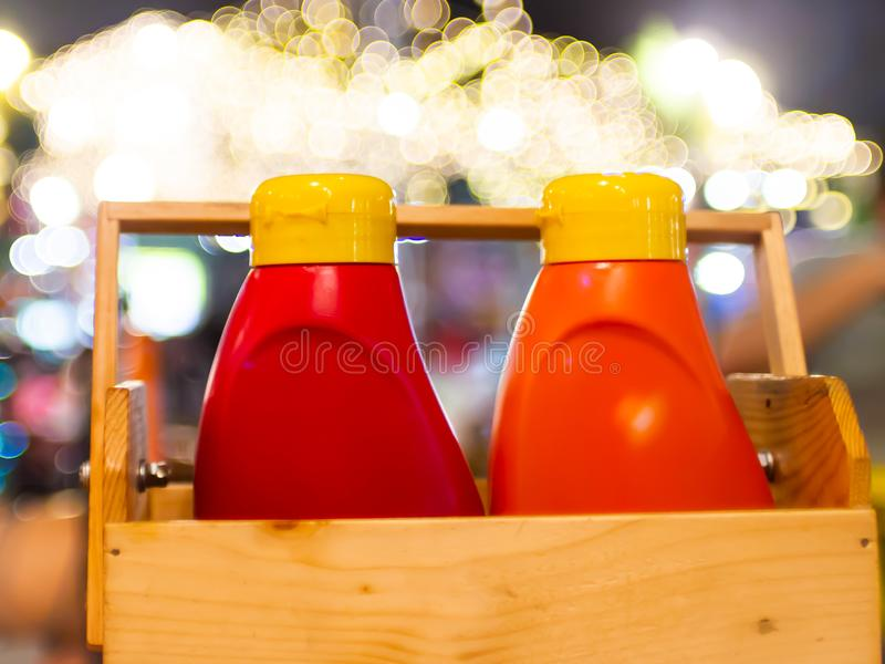 Set of red plastic bottles with pressed ketchup wasabi and mustard.  stock image