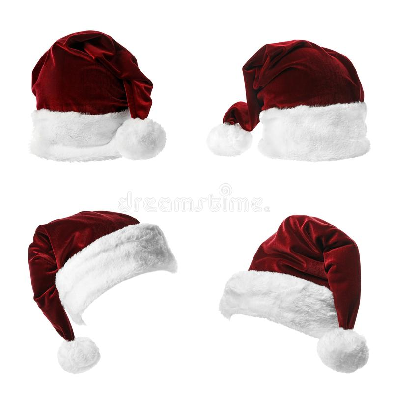Set of red Santa Claus hats on white stock image