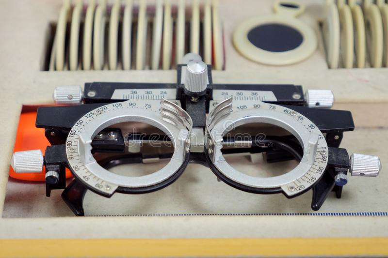 A set of replaceable lenses and a special universal trial ophthalmic setting for optometry and eyeglasses royalty free stock photo