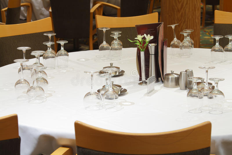 Set restaurant table with flowers. Menu and wine glasses royalty free stock photography