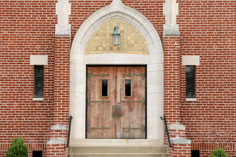 Retro old wooded iron hinge brick church doors stock images