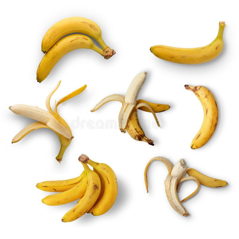 A set of ripe bananas on a white background. View from above. Isolated. Sweet food healthy natural snack tropical eating bunch yellow closeup collection stock photos