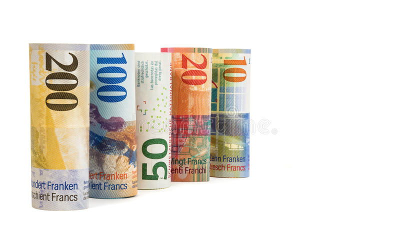 Set of rolled swiss franc banknotes. Isolated on white background with clipping path royalty free stock photo