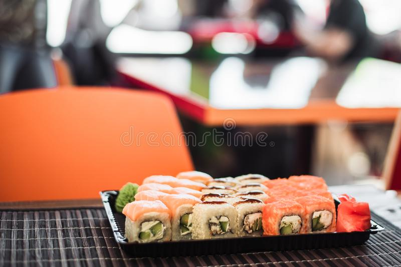 Set of rolls from California and Philadelphia in the background of a cafe. stock image