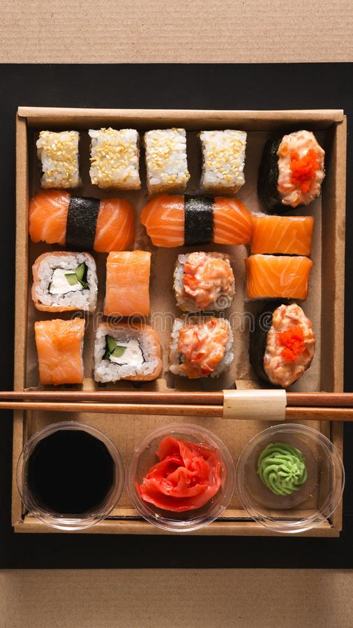 Set of rolls and sushi in delivery box for lunch royalty free stock images