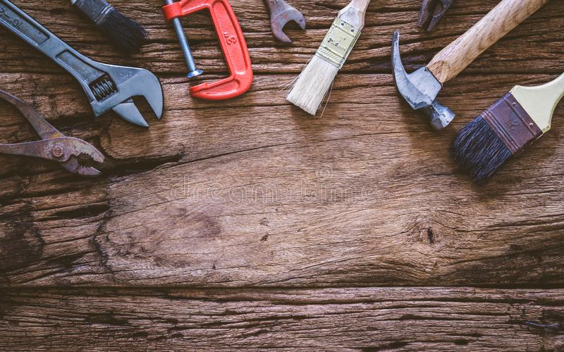 Set of rusty hand tools renovation on grunge wood. copyspace image. construction instrument background with blank space concept stock image