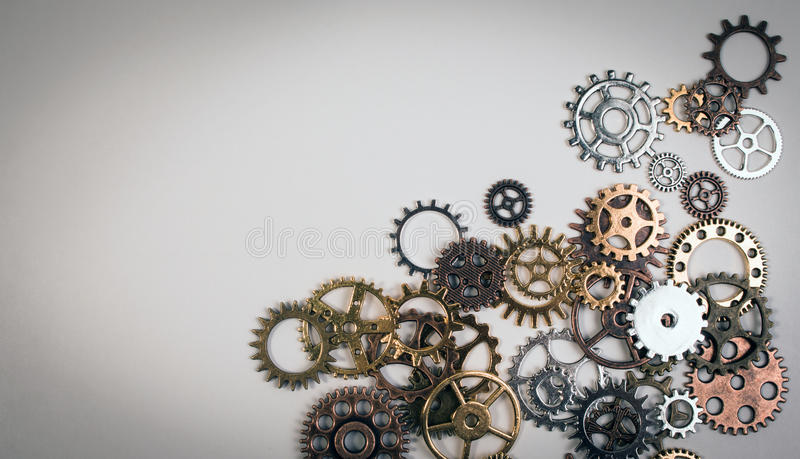 Set of rusty metal gears or cogs gear on a white background. stock image
