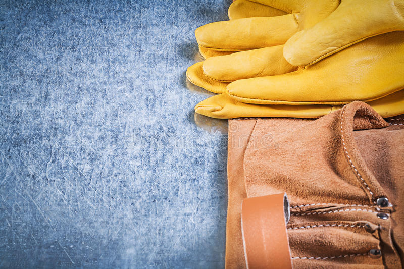 Set of safety working gloves tool belt on metallic background co. Nstruction concept royalty free stock images