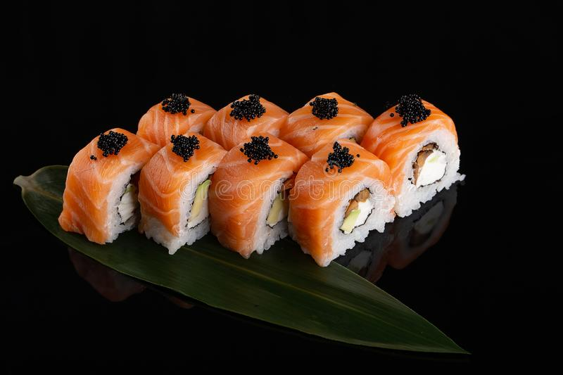 Set of Salmon rolls on a black background stock photography