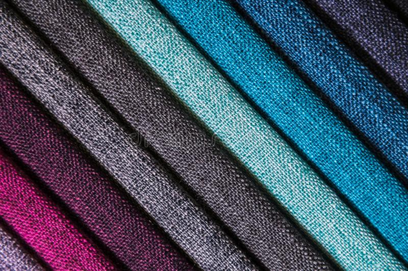 A set of samples of fabric furniture decoration lines of textile textures. Multicolored stripes upholstery. Mode and royalty free stock image