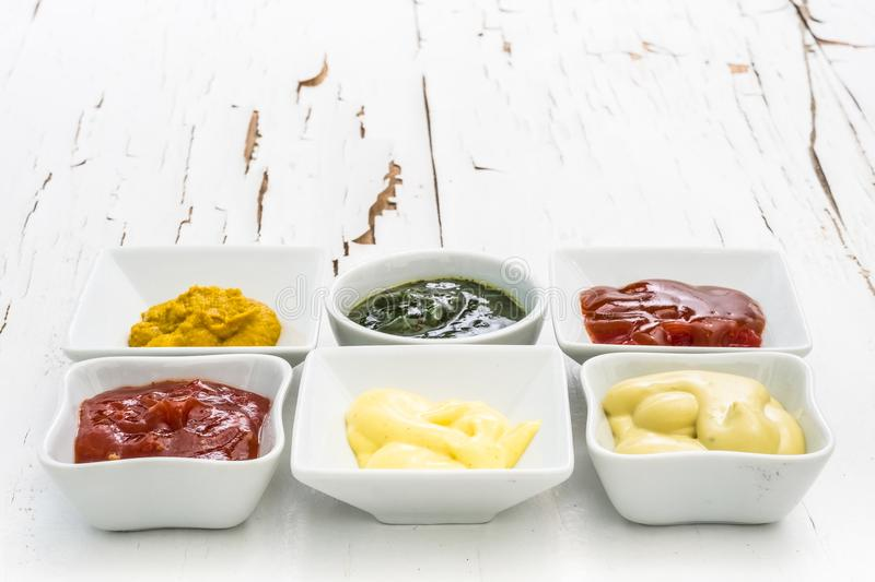 Set of sauces on a white table royalty free stock image