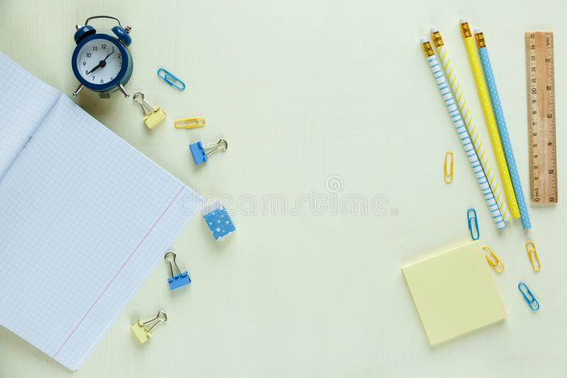 Set of school stationery back to school: pencils, clock, notepad, ruler on yellow background. education, lesson stock photography