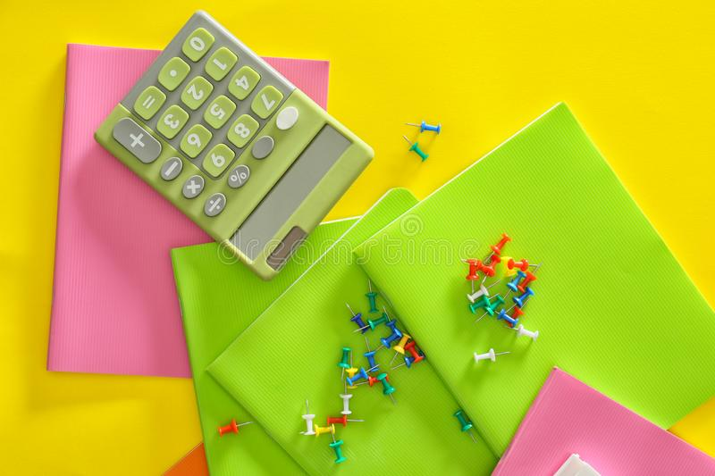 Set of school stationery with calculator on color background stock image