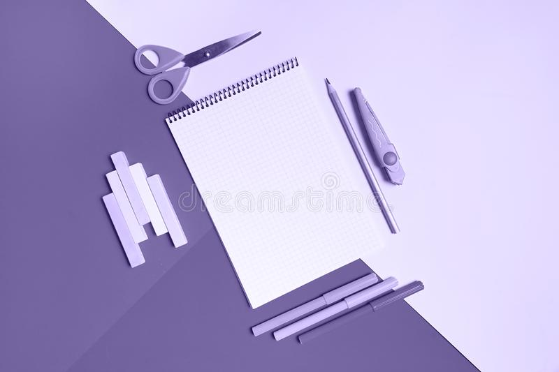 Set of school supplies on colorful background. free space for text. top view, flat lay. Ultra violet color style.  stock images