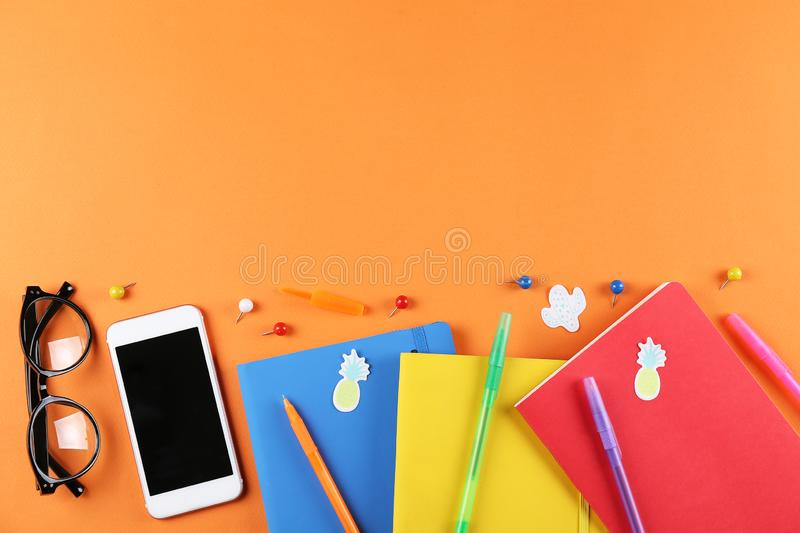 Set of school supplies on paper textured background royalty free stock photo
