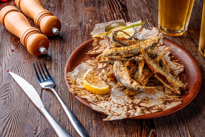 Set with seafood, small deep fried sea fish, food that is usually served with beer, horizontal orientation. Ciose up royalty free stock images