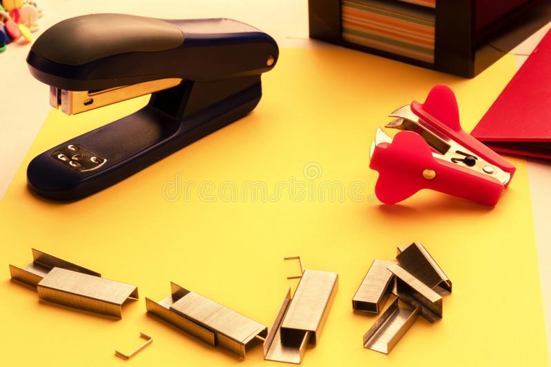 Set Sharp Stationery Items Stationery Knife Buttons Stapler Paper Clips. On on yellow stationery background stock images